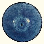 A blue plate from Gorgan, decorated with arabesque